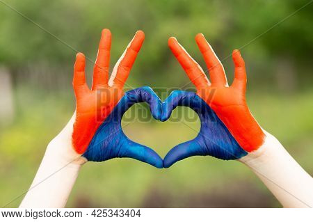 Love Mongolia Concept. Little Girl Show Hands In Heart Form Painted In Mongolia Flag Color. Mongolia