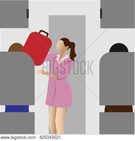 The Stewardess Puts The Suitcase On The Shelf.