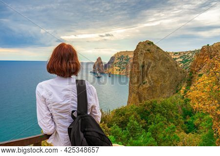 Rear View Of Beautiful Young Woman Admiring Amazing Landscape Of Sea And Mountainous Area. Teen Girl