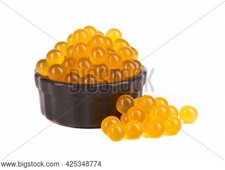 Yellow Tapioca Pearls For Bubble Tea Isolated On White Background. Tapioca Pearls In Black Ceramic B