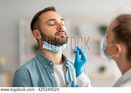 Nasal Coronavirus Pcr Test. Doctor Using Swab Stick To Take Covid Virus Specimen From Potentially In
