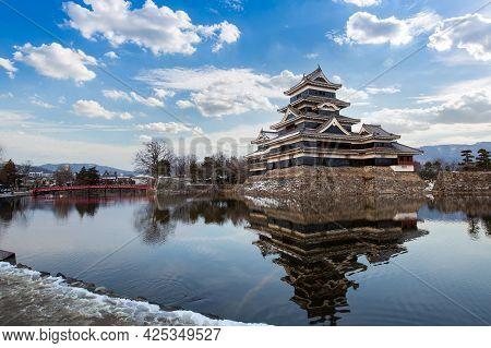 Old Castle In Japan. Matsumoto Castle Against Blue Sky In Nagono City, Japan. Castle In Winter. Trav