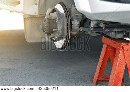 Urgent Repair Of The Car Suspension. Brake Disc And Hub Close-up. Lower Shooting Angle