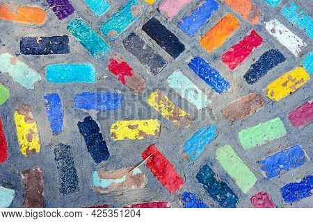Top View On Pieces Of Multicolored Ceramic Tiles Decorated In Garden. Old Pavement Of Tiles Textured