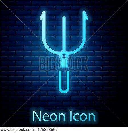 Glowing Neon Neptune Trident Icon Isolated On Brick Wall Background. Vector