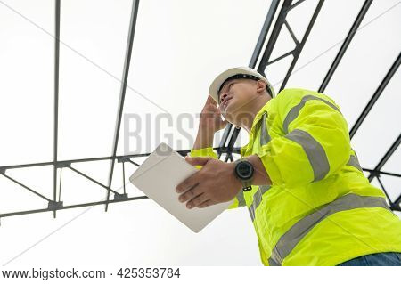 Inspector Civil Engineer Wearing Safety Helmet And Holding Tablet Inspection Check Detail Roof Struc