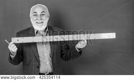 Size Measure. Senior Man Teacher Use Ruler While Drawing. Happy Tutor Man Draw With Ruler On Blackbo