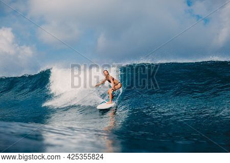 Surfer Woman At Surfboard On Perfect Wave. Young Sporty Woman In Ocean During Surfing.