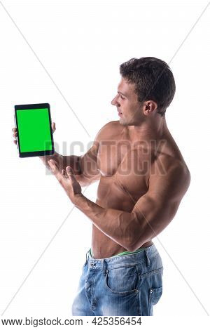 Sexy Muscular Shirtless Young Man Holding A Blank Tablet Pc