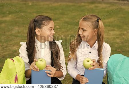 Our Brains Need To Be Fed With Vitamin Snack. Happy Girls Eat Apples On Green Grass. School Snack. S