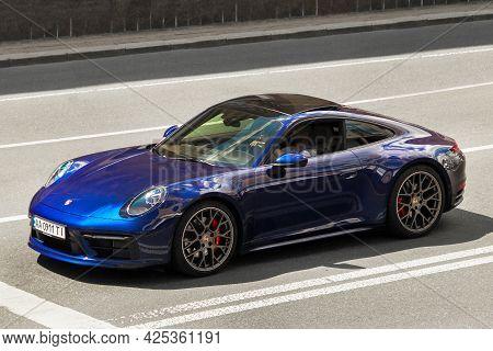 Kiev, Ukraine - June 12, 2021: Blue Supercar Porsche 911 Carrera S In The City