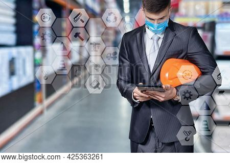 Civil Engineer Working On A Tablet On The Background Of A Warehouse.