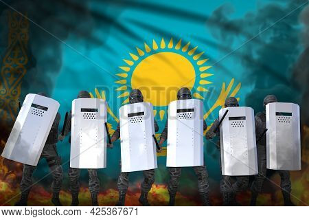Kazakhstan Protest Stopping Concept, Police Officers In Heavy Smoke And Fire Protecting Peaceful Peo