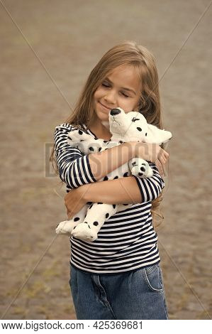 Because Your Baby Deserves Care. Happy Child Cuddle Toy Dog Outdoors. Love And Care. Play And Develo