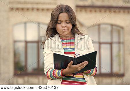 Doing Homework Isnt Fun. Small Child Do Homework Outdoors. Little Girl Write In Homework Diary. Home