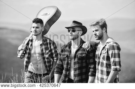 Guitar Players. Group Of People Spend Free Time Together. Hiking Adventure. Cowboy Men. Western Camp
