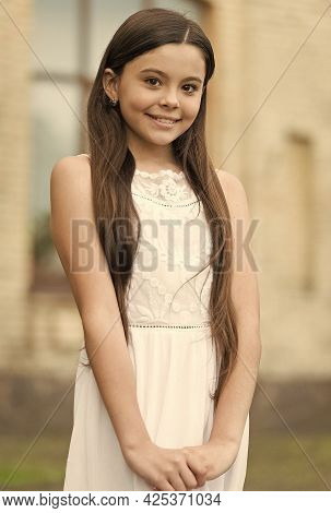 Happy Child Long Hair Smiling Face Urban Background Outdoors, Shy Lady Concept
