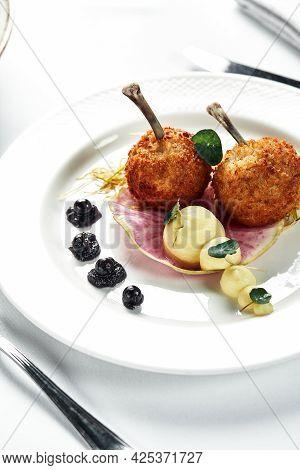 2 Kiev Cutlets Or Fried Chicken Kiev, Fried In Breadcrumbs, On A Light Tare, On A Festive Table, Cop