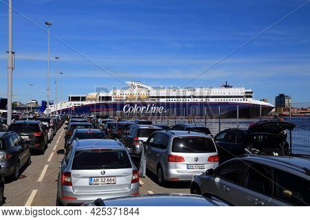 Kristiansand, Norway - July 31, 2020: Cars Wait In Line To Board Color Line Superspeed Ferry From No