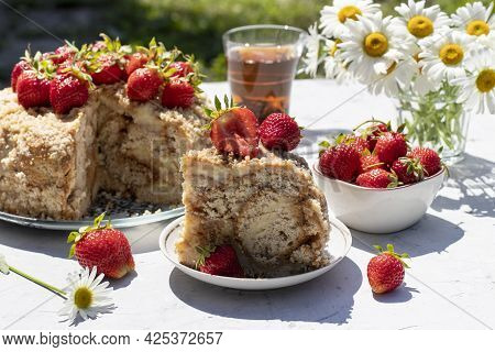 Homemade Gingerbread Cake Garnished With Fresh Strawberries On Gray Table With Shadows. Summer Still