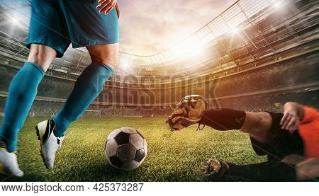 Close Up Of A Football Action Scene With Competing Soccer Players At The Stadium