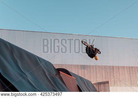 Bmx Rider Doing Trick On Ramp In Skate Park