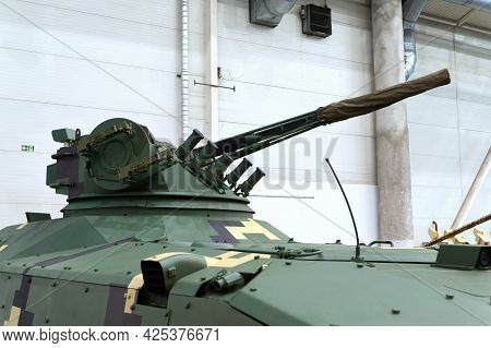 Infantry Fighting Vehicle. Close-up Of A Tracked Armored Vehicle Tank With A Combat Cannon Module At
