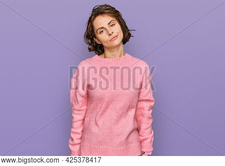 Young hispanic woman wearing casual clothes looking sleepy and tired, exhausted for fatigue and hangover, lazy eyes in the morning.