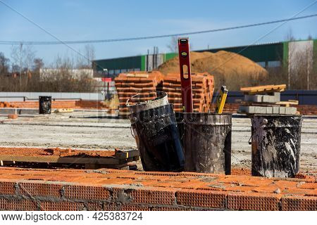 Construction Levels And Dirty Buckets At The Construction Site. Construction Site Landscape. Working