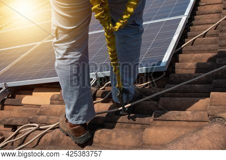 Solar Worker Cleaning Photovoltaic Panels With Brush And Water. Photovoltaic Cleaning, Before And Af