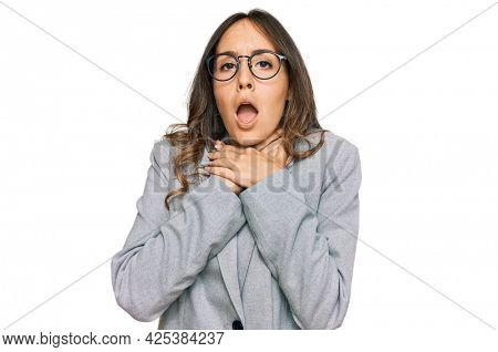 Young brunette woman wearing business clothes shouting and suffocate because painful strangle. health problem. asphyxiate and suicide concept.