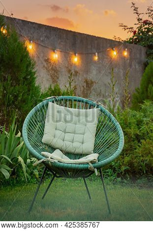 Pillow On Modern Chair In The Garden. Garden Chair With A Pillow In Summer.