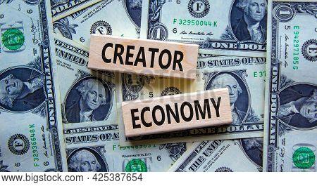 Creator Economy Symbol. Wooden Blocks With Words Creator Economy On Beautiful Background From Dollar