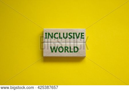 Inclusive World Symbol. Wooden Blocks With Words Inclusive World On Beautiful Yellow Background. Bus