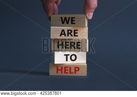 Support And Help Symbol. Wooden Blocks With Words 'we Are Here To Help'. Businessman Hand. Beautiful