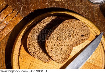 Still Life - Yeast-free Buckwheat Bread, Various Types Of Black Bread, A Knife, And A Linen Napkin O