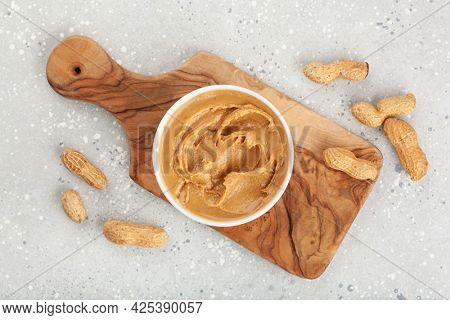 smooth peanut butter in bowl on gray background