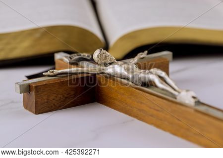 Holy Bible On Of The Christian Cross The Hope Of Mankind For Salvation On Way To God Through Prayer.