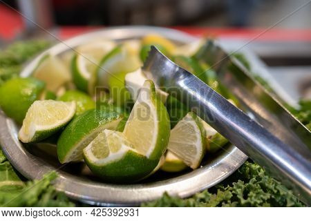 Lime Slices Cut Into Quarters And Served With Tongs To Add To Your Mexican Food Meal At The Salsa Ba