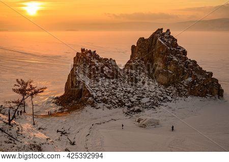 Sunset View Of Shaman Rock One Of Sacred Place In Frozen Lake Baikal In Winter Season Of Siberia, Ru