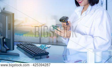 Pharmacist Scanning Barcode Of Medicine Drug In A Pharmacy Drugstore.