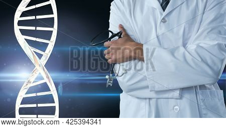 Mid section of male doctor holding a stethoscope against dna structure on blue background. medical research and science technology concept