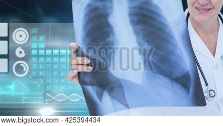 Mid section of female doctor examining x-ray report against medical data processing. medical research and science technology concept