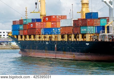 Labuan,malaysia-feb 2,2018:shipping Containers Stacked On Cargo Ship At Port Of Labuan Ft,malaysia.