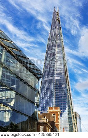 London, UK - 29th Septemeber 2016: The Shard, London, the tallest building in the UK and is 72-stories high. Seen here from a Southwark street against a summer blue sky background.