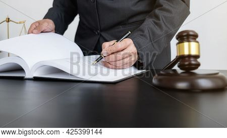 Professional Lawyer Considering With Contract Papers In Courtroom. Justice, Law, Attorney And Court