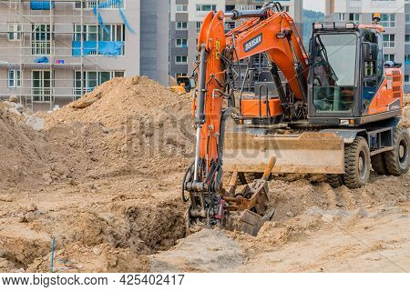 Daejeon; South Korea; June 20, 2021: Doosan Backhoe Sits Idle At Construction Site In Sintanjin Dong