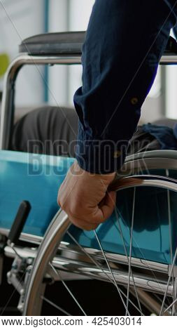 Close Up Independence Handicapped Man In Wheelchair Entering In Company Office, Moving Alone Startin
