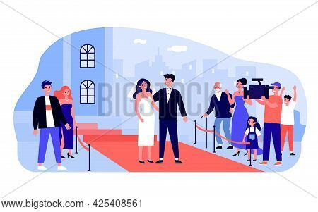 Married Celebrity Couple On Red Carpet. Bride Wearing White Wedding Dress And Veil, Broom In Tuxedo,