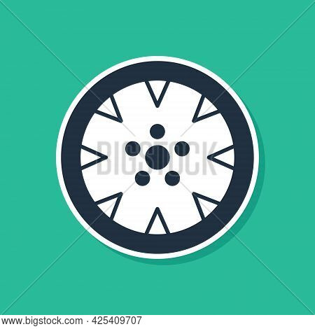 Blue Alloy Wheel For A Car Icon Isolated On Green Background. Vector